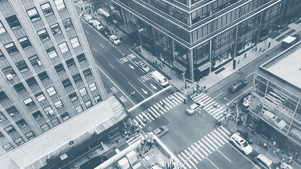 An overview looking down at a street intersection in a city